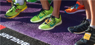 Photo of runners feet at the BolderBOULDER start line
