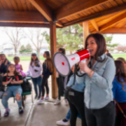 Charla holding megaphone with group of students