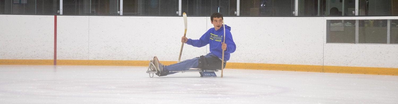 boy on ice sled