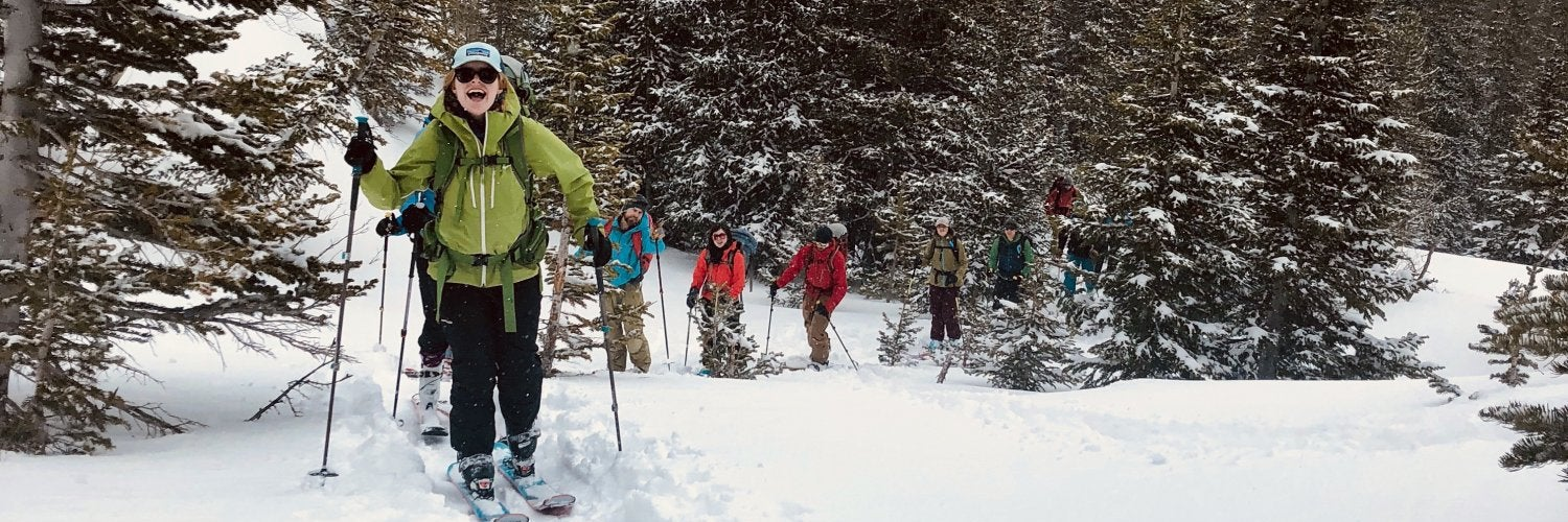Students skiing in a single file line