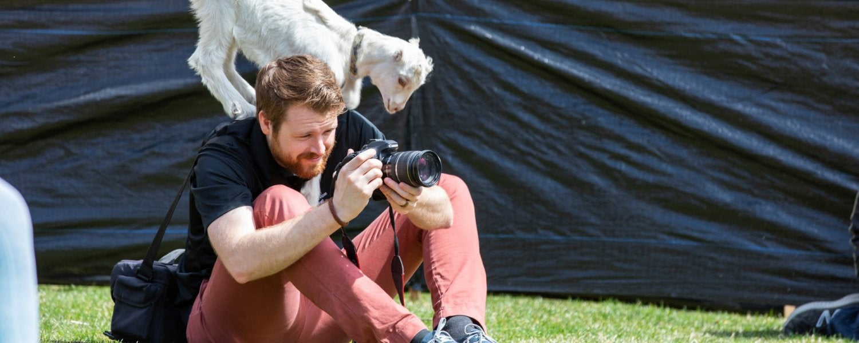 Photographer taking photos during goat yoga