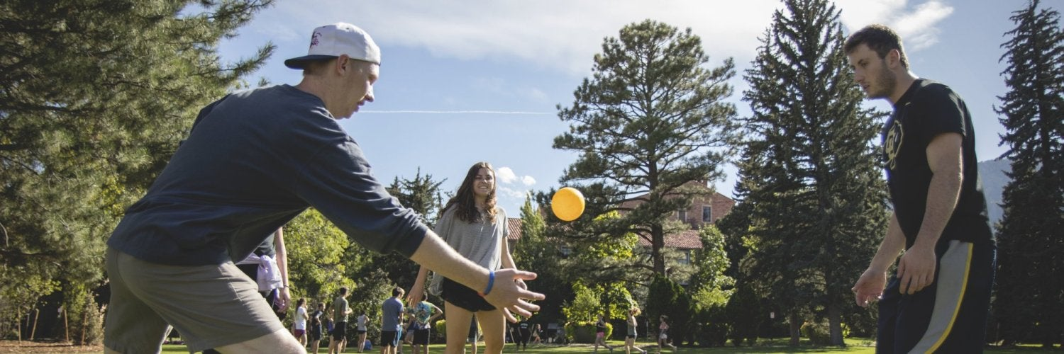 Students playing spike ball on Farrand field.