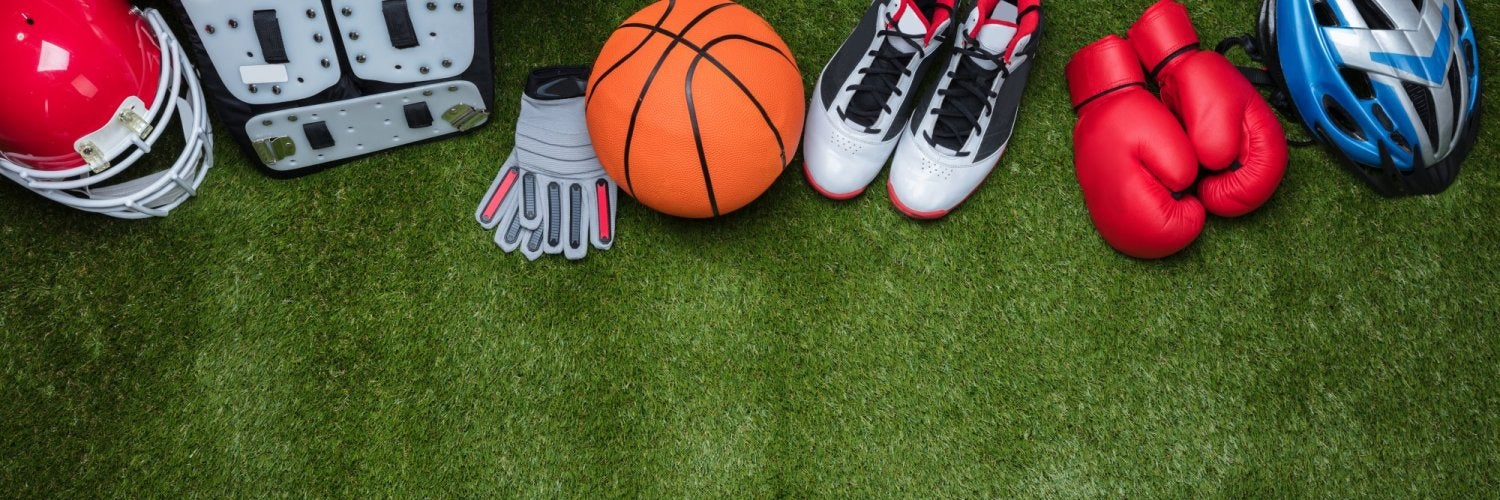 Sports equipment laid out on turf