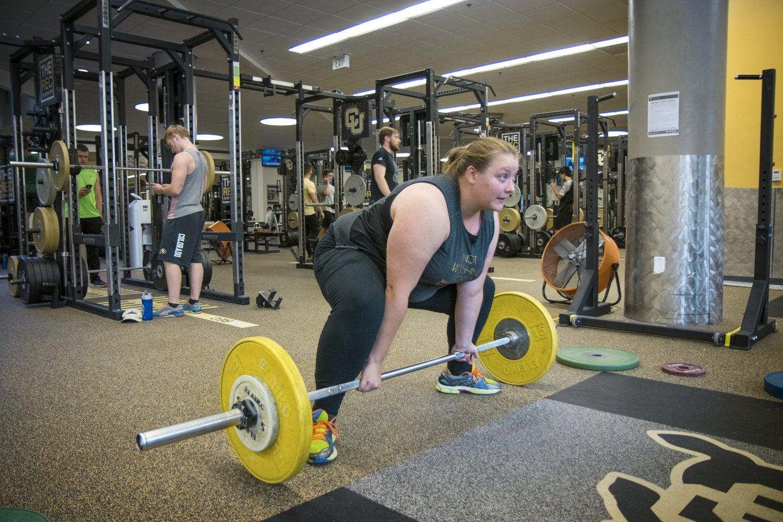 female weightlifter deadlifting on a cu mat