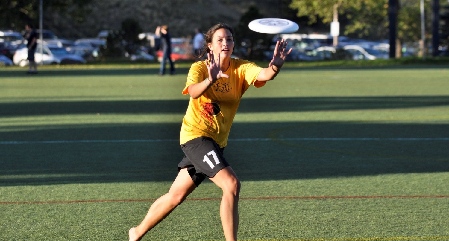 woman catching a frisbee