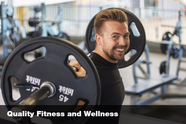 """smiling man lifting heavy weight with text """"quality fitness and wellness"""""""