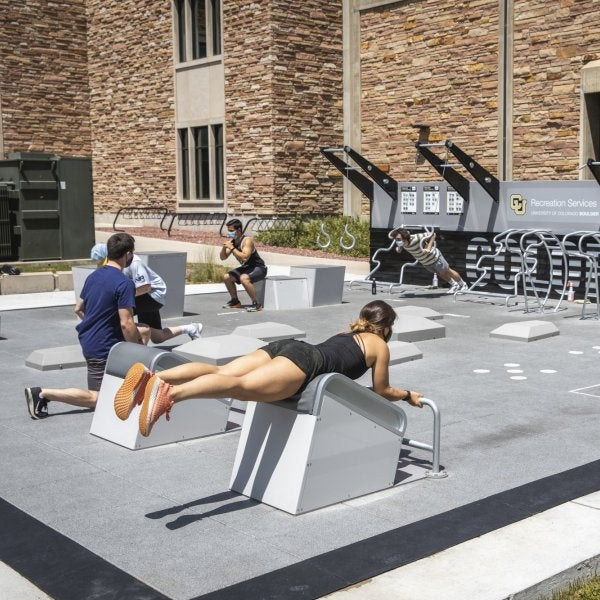 the outdoor fitness court in use