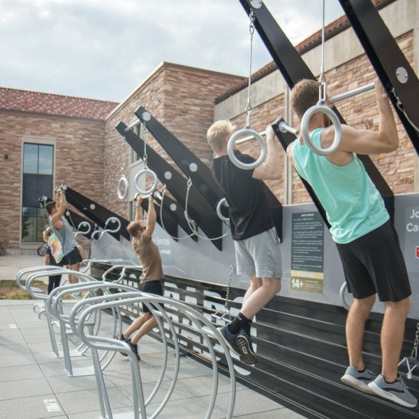 Students working out on outdoor fitness court