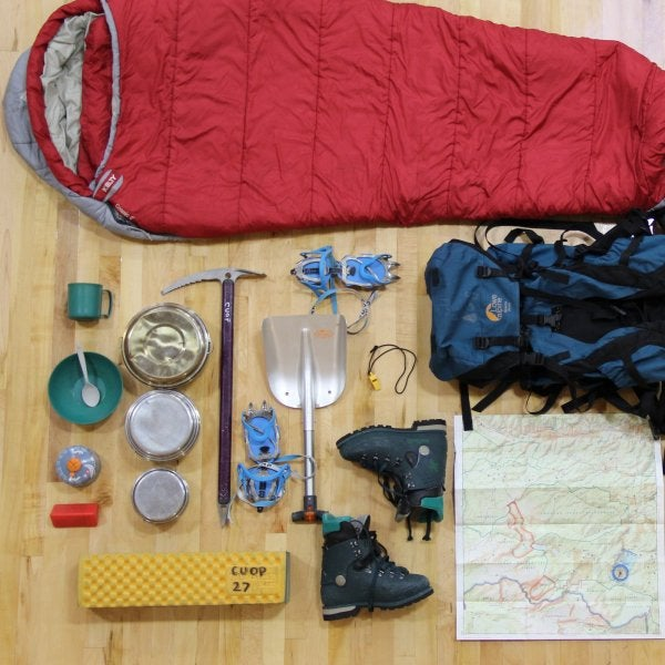 Backpacking equipment laid out on the floor.