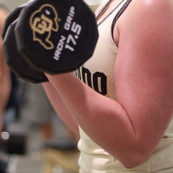 Female student doing a bicep curl
