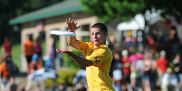 Men's ultimate player catching frisbee