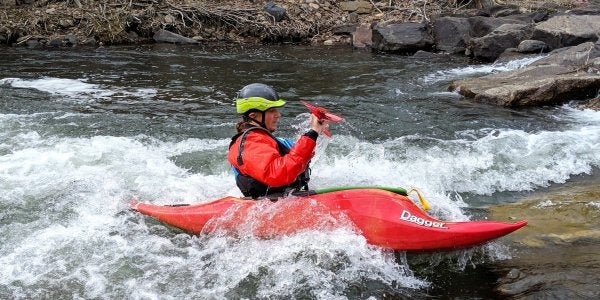 Student kayaking in the river