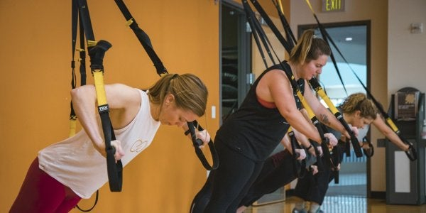 Students using TRX ropes