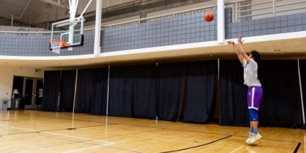 lone student shooting a basketball