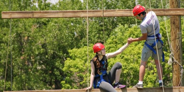 Two people on high ropes course