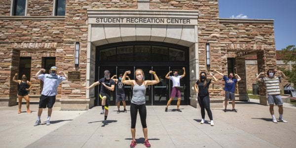 students flexing outside of rec center