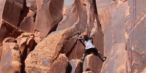 climbing up a cliff face