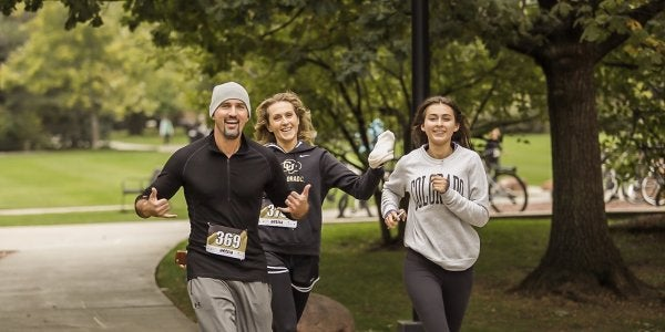 family running on campus