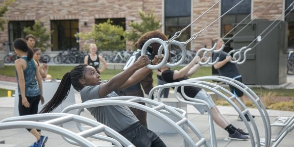 Students working out on the fitness court
