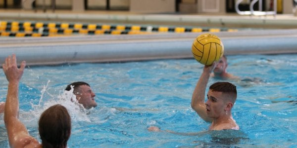 Students playing water polo