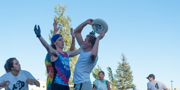 Students playing ultimate frisbee on kitt north