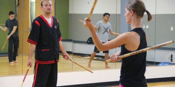 People practicing Eskrima