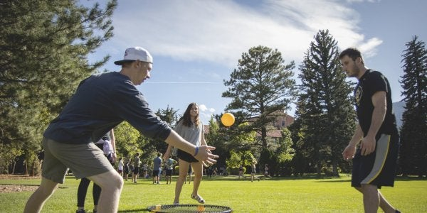 Students playing spike ball on farrand field