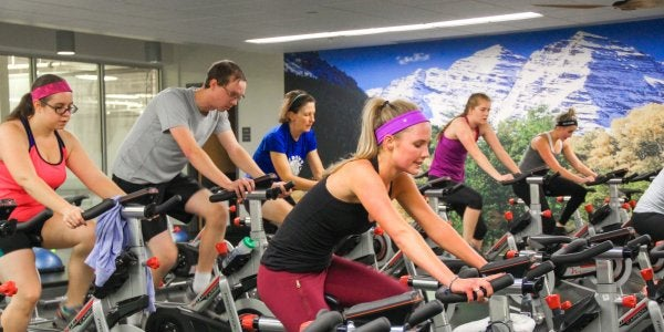 People in a cycling class