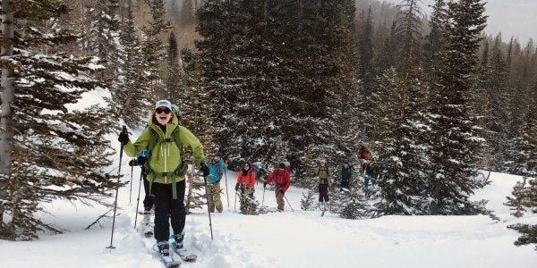 Students skiing in a line