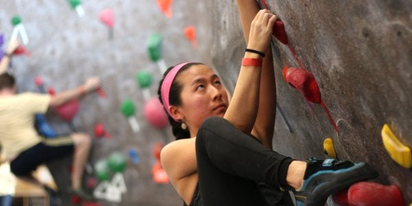 girl on bouldering wall