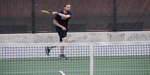 Person hitting tennis ball