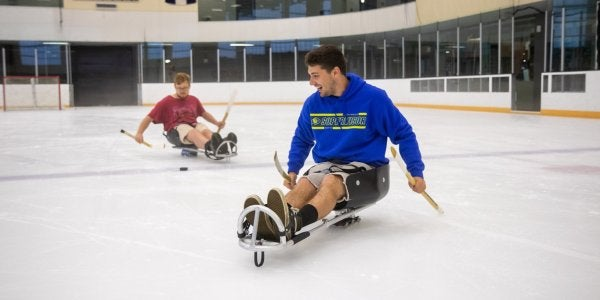 students in ice sleds