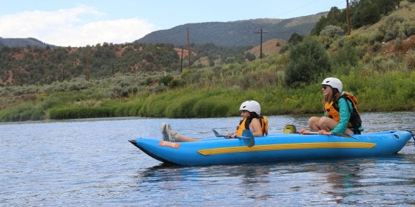 students in a raft