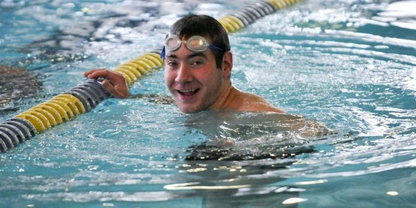 smiling man in a pool