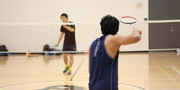two men playing badminton