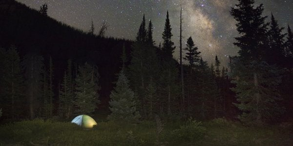 Camping tent under stars