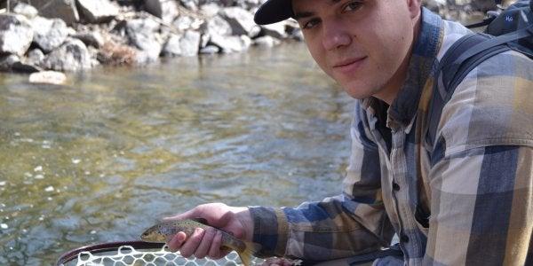 Student holding fish
