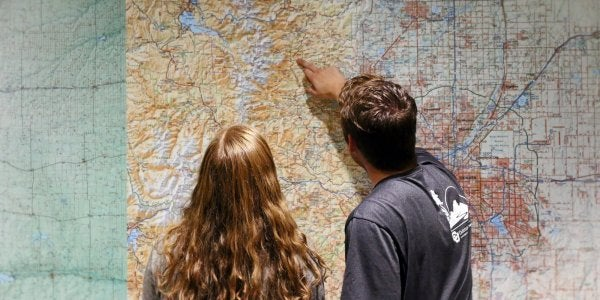 Students looking at a map of Colorado