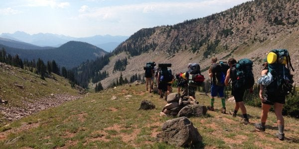 large group of students hiking