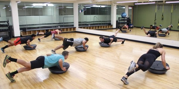 students working out in a fitness room