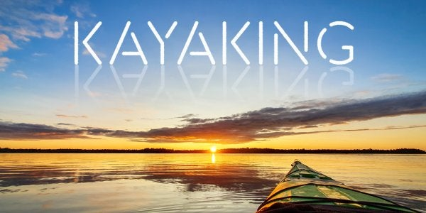 """a kayak with the word """"kayaking"""" written in the sky above it"""