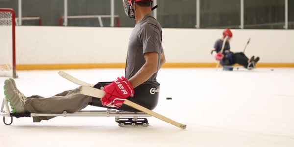 student using an ice sled