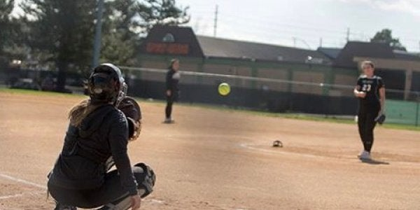 Softball player catching ball