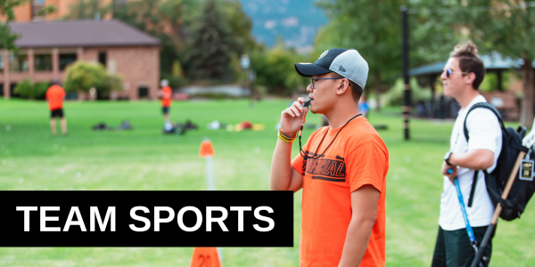 Sports official blowing a whistle