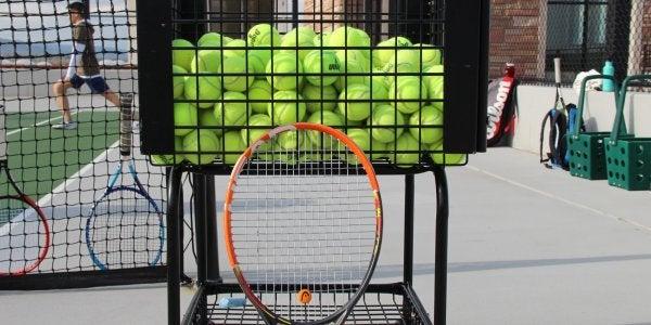 tennis balls and a racquet