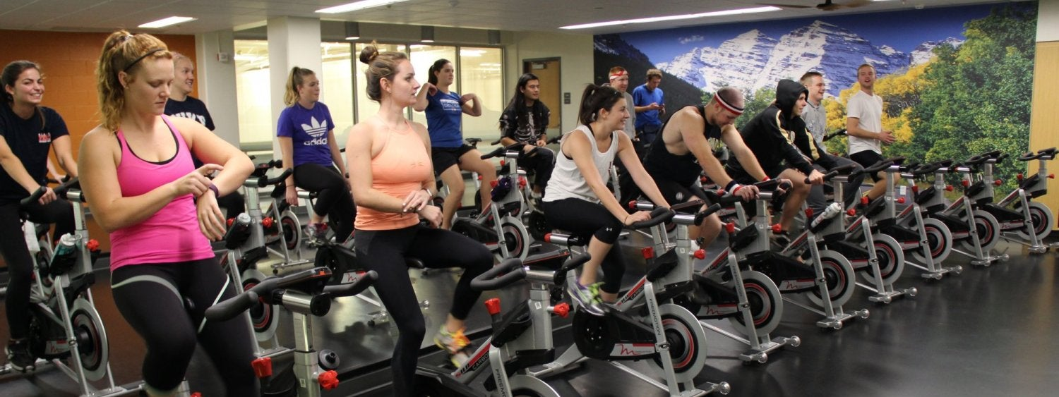 Students enjoying a cycling class at The Rec.