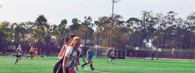 Women playing field hocky