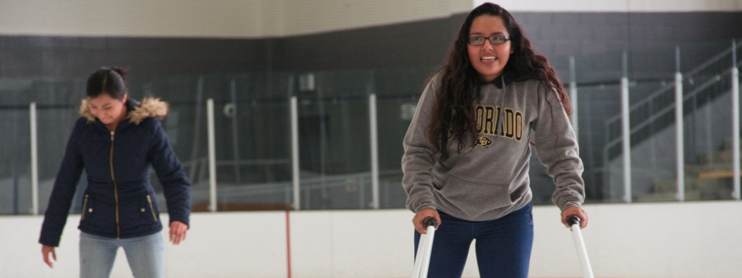 Woman skating on ice rink
