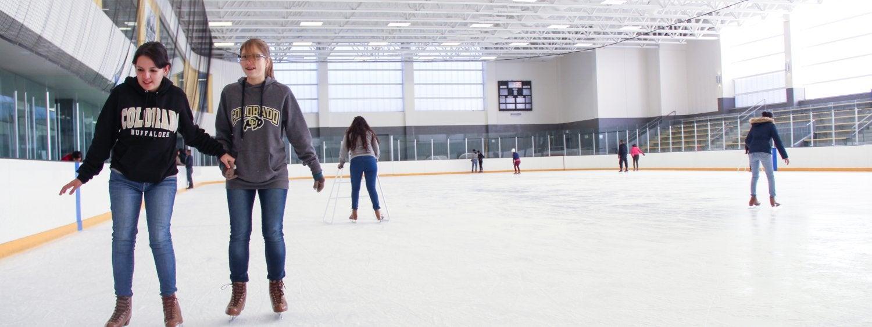 Women skating on ice rink
