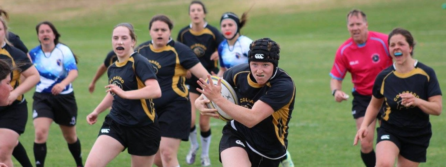 Women's Rugby game running